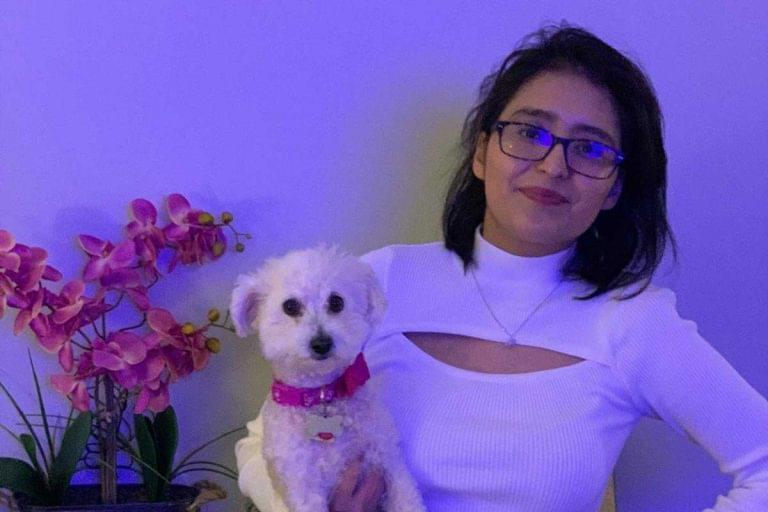 After contracting COVID-19 and ending up on life support, Mayra Ramirez received a double-lung transplant on June 5, 2020, at the age of 28. She poses with her dog in this photo taken in January 2021.