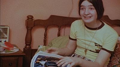 Winnie Wright holding a magazine