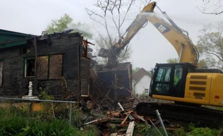 A house in Danville's Rabbittown neighborhood was torn down by a Public Works employee using a Caterpillar excavator, on April 28, as part of the city's building demolition program.