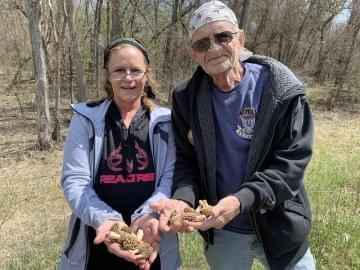 Wendy Porter and her father Roger Jensen show off the morel mushrooms they found in the woods.