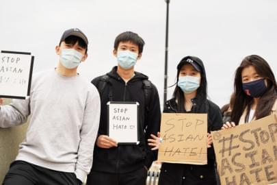"A group of University of Illinois students hold signs that say ""Stop Asian Hate"" at a rally in downtown Champaign in March 2021. Students have been going to the University's Asian American Cultural Center about Asian racism since long before the pandemic, center director David Chih said."
