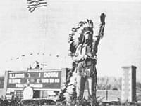 old photo of Chief Illiniwek at football game
