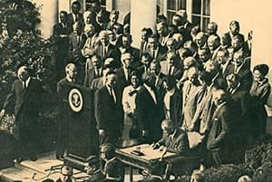 President Johnson signing the 1965 law that created the NEH