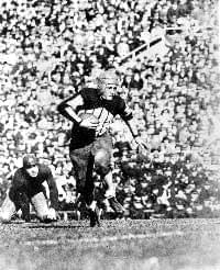 Red Grange running with football