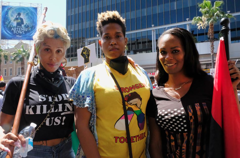 Trans women Carlisha Brown, from left, Nina Barkers, and Vanessa Warri, of Los Angeles, attend the All Black Lives Matter march, organized by black LGBTQ+ leaders, on Sunday, June 14, 2020, in Los Angeles.